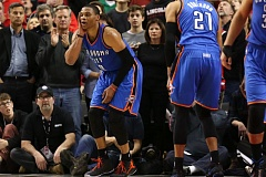 Photo Credit: COURTESY OF DAVID BLAIR - Oklahoma City guard Russell Westbrook (left) holds his head after taking a blow from a teammate in the final seconds of Friday night's game against the Trail Blazers.