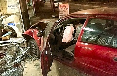 Photo Credit: COURTESY OF SHON BOULDEN - A deflated airbag hangs over the steering wheel, after the driver was removed from the Toyota Corolla he smashed into the Sellwood UPS Store.