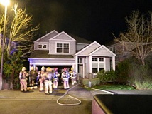 Photo Credit: TVF&R - Tualatin Valley Fire & Rescue crews say a fire in a Tigard garage likely started from smoking marterials that were not properly disposed of.