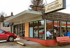 Photo Credit: DAVID F. ASHTON - A large window at the Woodstock Laundry is boarded up - after burglars smashed it, to grab the change machine.