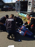 Photo Credit: COURTESY OF COLUMBIA RIVER FIRE & RESCUE - Columbia River Fire & Rescue personnel strap a cyclist into a stretcher after a bicycle-versus-car crash in uptown St. Helens on Monday, March 2.