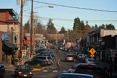 Photo Credit: CONNECTION PHOTO: KELSEY OHALLORAN - Cars drive through Multnomah Village. The area may be designated as a neighborhood center in the citys 2035 Comprehensive Plan.