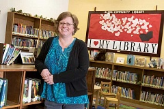 Photo Credit: TIMES PHOTO: JONATHAN HOUSE - Terri Palmer recently took over as director of the Aloha Community Library.