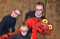 Photo Credit: PHOTO BY MICHELLE LEIGH - Georgia Hatch, Kimmie Christensen and Alexis Davis work together to create Ka, a menacing and enormous snake.