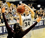Photo Credit: SETH GORDON - Eyes on the prize - Senior Dacia Heckendorf elevates on her way to the basket during George Fox's 66-61 victory over Puget Sound in the NWC title game Saturday.