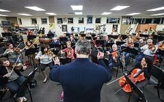 Photo Credit: TIMES PHOTO: JONATHAN HOUSE - Conductor Travis Hatton leads the Beaverton Symphony Orchestra during a practice at Valley Catholic High School.