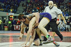 Photo Credit: JOHN WILLIAM HOWARD - Scappoose's Tyson Broadbent took fourth in the 195-pound bracket at the OSAA 4A wrestling state championships, at the Veterans Memorial Coliseum in Portland on Feb. 27 and 28.