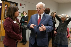 Photo Credit: TIMES PHOTO: JONATHAN HOUSE - Kevin Concannon, an undersecretary at the U.S. Department of Agriculture, speaks with Marni Kuyl, director of Washington County Health & Human Services, during a tour of two nutritional programs at the Beaverton Activities Center.