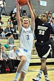 MATTHEW SHERMAN - Lakeridge's McKay Burg gets fouled on a strong drive to the basket during Tuesday's playoff win over West Albany. The Pacers were down by 12 points with three minutes left in the third quarter before rallying to win.