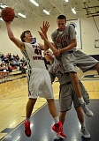 VERN UYETAKE - Lake Oswego's Max Dinesen puts up a shot after grabbing an offensive rebound in Tuesday's playoff win over Westview. Dinesen had a double-double in the game.