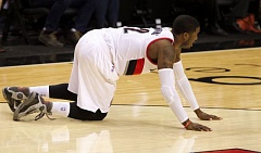TRIBUNE PHOTO: JAIME VALDEZ - Blazers guard Wesley Matthews goes down with a season-ending Achilles tendon injury early in the second half Thursday night at Moda Center.