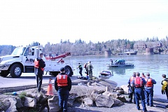 PHOTO COURTESY: CLACKAMAS FIRE - A pickup is towed out of the Willamette River, where a driver died Wednesday morning.