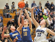 SETH GORDON - Just out of reach - Taylor Rarick (left) and Sydney Kosmicki fight for a rebound during Newberg's 64-48 loss to Grant March 4 in the opening round of the OSAA 6A playoffs.