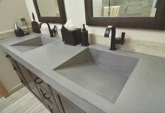 REVIEW/TIDINGS STAFF: VERN UYETAKE - Tony Russo and Cissy Litvins expanded master bathroom now includes his-and-hers sinks and a concrete countertop.
