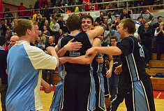 VERN UYETAKE - Jake Spurgeon gets a hug from Eric Dungey after Spurgeon's late three-pointer in overtime helped propel Lakeridge past No. 6 David Douglas and into the state tournament.