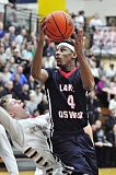 MATTHEW SHERMAN - Lake Oswego's Rodney Hounshell drives to the basket during the Lakers' second-round playoff game against Southridge last week.