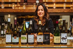 SUBMITTED PHOTOS: JOSH CHANG, SE WINE COLLECTIVE - Kate Monroe poses with wines served at the Cuisinieres at the Collective dinner recently. Featured were wines from the Loire region of France and those made by S.E. Wine Collective members which were inspired by the Loire wines.