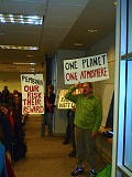 TRIBUNE PHOTO: STEVE LAW - Protesters silently wave posters at Tuesday's hearing on Pembina's proposed propane export terminal in North Portland.