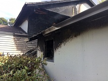 TVF&R - The exterior of this fourplex on Gingham Lane in south Beaverton shows the effects of today's fire.
