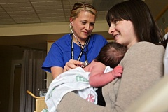TIMES PHOTO: JAIME VALDEZ - Delivery Nurse Jeni Fitzpatrick listens to the heartbeat of baby Levi Vial as mom, Kennebec, watches on at the Family Birth Center at Legacy Meridian Park Medical Center.