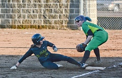 JOHN WILLIAM HOWARD - St. Helens senior Michelle Sass slides into third in the bottom of the second inning as the Lions had already built up a comfortable 6-0 lead.