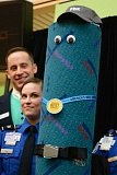 TRIBUNE PHOTO: JOHN VINCENT - PGE/SOLV Starlight Parade Chairman Jeff Deering and TSA officer Andrea Green present the PDX Carpet as Grand Marshall of the 2015 Rose Festival Starlight Parade.