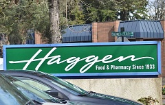 REVIEW PHOTOS: VERN UYETAKE - New signs welcome Lake Oswego shoppers to the Haggen Foof & Pharmacy store on Boones Ferry Road. The former Albertsons opened its doors under the new brand Thursday.