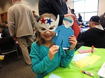 SUBMITTED PHOTO  - Kids enjoyed crafts and other superhero-themed activities during Spring Break 2014 at the Beaverton City Library. This years theme is Lions, Tigers, and Bears, featuring a series of programs for teens and kids from March 21-29.