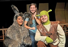 PAMPLIN  MEDIA GROUP: VERN UYETAKE - Two talented casts traditionally present the annual middle-school musical. This year, the M cast features Matthew Snyder as Donkey, Angela Tinio as Fiona and Cameron Massey as Shrek.