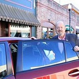 SUBMITTED PHOTO - Mayor Denny Doyle had his photo taken last year when he welcomed Uber to Beaverton.