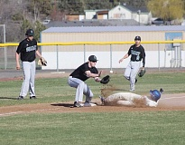 JEFF WILSON/THE PIONEER - Broc Sanders slides safely into third base during Madras' season-opening game against Summit last week. Sanders will be counted on this year for not only defense in the field, but some senior leadership as well on what is a very young team.