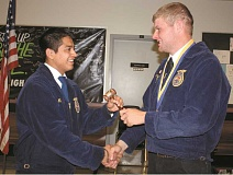 PEGGY SAVAGE - Luis Mendoza, left, accepts the gavel as Molalla FFA president last May. Now he has been named the state president of Oregon FFA.