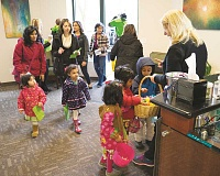 HILLSBORO TRIBUNE FILE PHOTO: CHASE ALLGOOD - Children bounded into Orenco shops in hopes of getting some eggs last year.