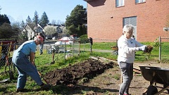 PHOTO COURTESY OF LESLIE POHL-KOSBAU - Volunteers pitch in during a work party for Crossroads Community Garden.