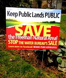 TRIBUNE FILE PHOTO - Neighbors of the Freeman water tank site put signs in their front yards opposing a city plan to sell the property to a developer.