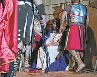 NEWS-TIMES FILE PHOTO - Blood stains the floor, the fingers of the guards and the robe of Jesus, as played by Filegonio Ramon Estrada during St. Anthonys 2014 performance of the Passion Play. Jesus will be played this year by Jose Luis Sayago.
