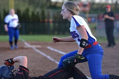 PAMPLIN MEDIA: DAVID BALL - Madras pitcher Leah Buck tries to put the tag on Corbetts Kara Moritz, who slid in safely on the play to start the scoring in the sixth inning.