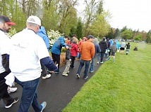 REVIEW PHOTO: CLIFF NEWELL - Walkers formed a long line in Foothills Park on Saturday morning as they set out to retrieve water at Walk4Water8, a fundraiser for Lake Oswergo-based WaterAfrica.