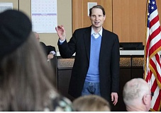 PHOTO CREDIT: HOLLY M. GILL  - .US. Sen. Ron Wyden responds to education concerns from Madras High School teacher Carrie McPeak, at left, during his annual town hall meeting on Feb. 14 at the Madras City Hall.