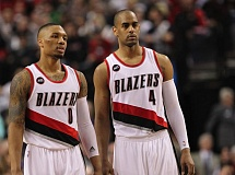 TRIBUNE FILE PHOTO: JAIME VALDEZ - Arron Afflalo (right), with fellow Blazers guard Damian Lillard, says he will give his injured shoulder another day of rest and testing before deciding whether to play against Memphis on Wednesday night.