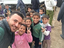 SUBMITTED PHOTO - Iraqi children rush to receive soccer balls after a Soccer Salam airlift to Baghdad in January. Funds donated by the Lake Oswego Rotary Club are helping children in the war-torn nation.