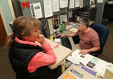 REVIEW PHOTO: VERN UYETAKE - Matt DAndre helps Lisa Rueben sign up for a dance class at the Parks & Recreation Departments offices in the West End Building. The WEB also is home to the Lake Oswego-Tigard Water Partnership, the McKenzie Teen Lounge and a variety of classes, camps and special events.