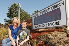 TIMES PHOTO: JAIME VALDEZ - Aimee DeCastro and her son Howard sit in front of Horizon Christian High School. DeCastro will be leading the Arrowsmith Program at the school next year, which Howard will be a participant in.