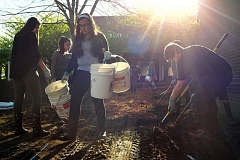 TIMES PHOTO: JAIME VALDEZ - Freshman Mariana Rodriguez carries buckets to be filled with bark while working on a wetland restoration project in Kelly Perry's biology class at Tualatin High School.