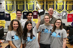TIMES PHOTO: JAIME VALDEZ - Colette Petersen, 18, who is a Tualatin High senior and the marketing director for the school's FBLA, holds the championship trophy that her team recently won on the state-wide competition. From her left pictured clockwise is; Mallory Reser, Malachi Seib, Elijah Raffo, FBLA advisor Jim McCaffrey, Erin Brohoski and Mckenzie Morrow.