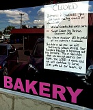 PAMPLIN MEDIA GROUP FILE PHOTO - Aaron and Melissa Klein taped this sign in the window of their Gresham bakery in September 2013 when they closed the store and moved their bakery business into their home.