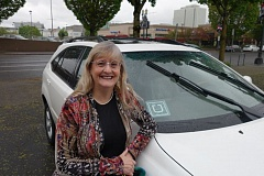 JOSEPH GALLIVAN - Lexus owner Amy Hall can now operate legally in the Portland as well as the suburbs where she has been an UberX driver since January 2015.