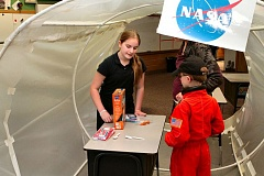 DAVID F. ASHTON - In the sixth-graders International Space Station, Lilly Mildenberger takes a tour through the eating station. This is an interesting project, especially when thinking about living in zero gravity, she said.
