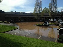 CITY OF TIGARD - A fire hydrant struck by a semi-truck sent water spilling into the roads and nearby businesses on Monday afternoon.