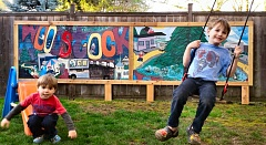 Woodstock residents Max and Jack Loch enjoy the old Papaccinos mural that their Dad upcycled, with help from neighbors Greg and Clay Giest.